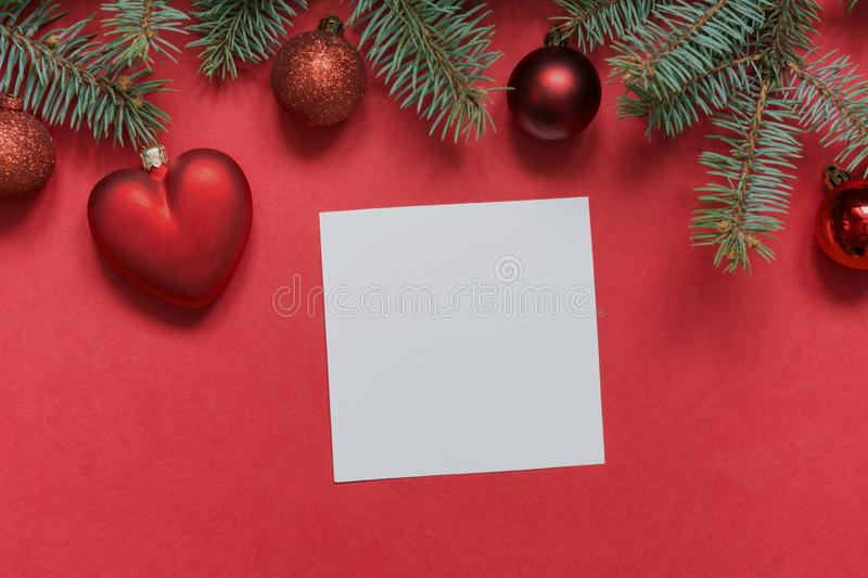 Christmas border of red balls and heart, evergreen branches on red. View from above, flat lay. Xmas holiday. Template, mockup,. Greeting New Year card stock images
