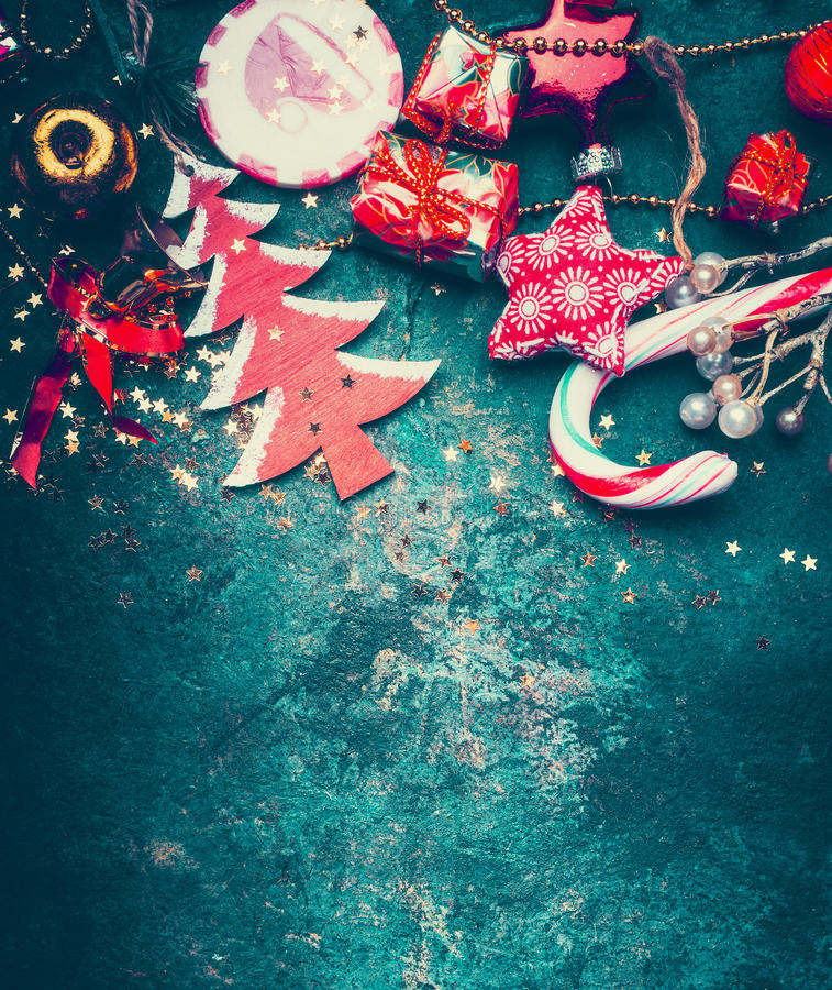 Christmas border with red decoration, christmas tree and candy on dark blue vintage background, top. View royalty free stock photography