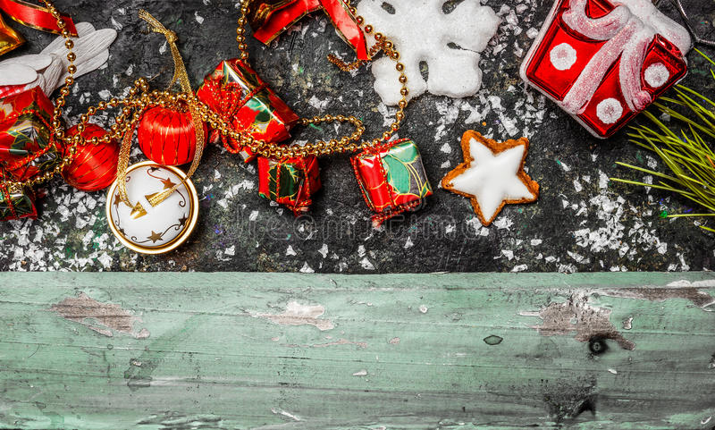 Christmas border with red holiday decorations on rustic wooden background. Top view royalty free stock images