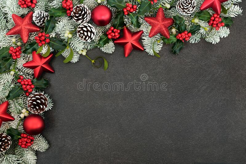 Christmas Border with Red Star Baubles and Winter Greenery stock photography