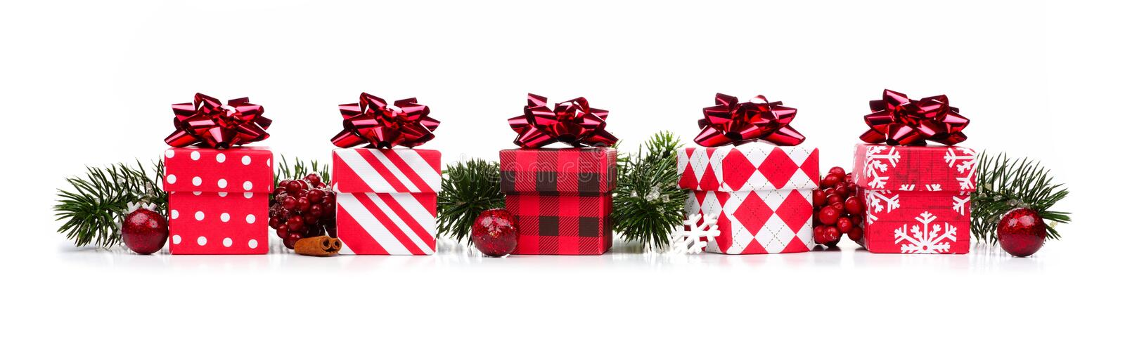 Christmas border of red and white gift boxes and branches stock image