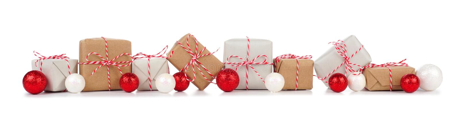 Christmas border with brown and white gift boxes on white stock photos