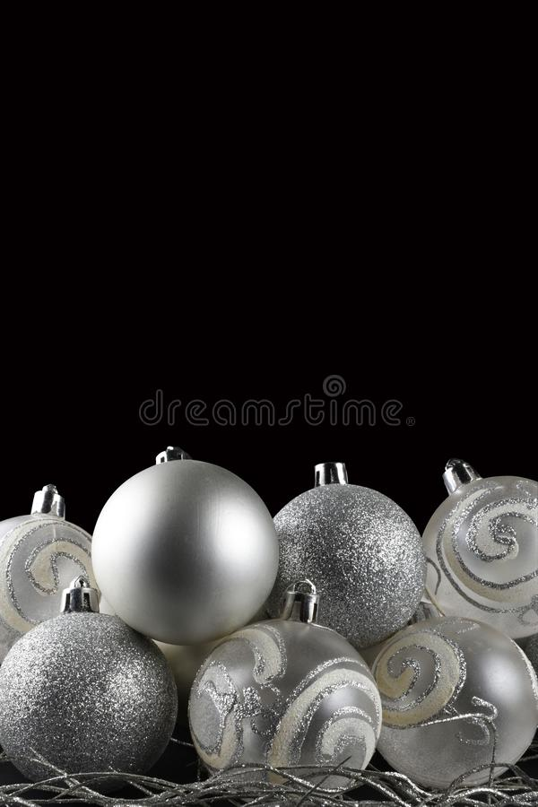 Christmas border of silver ornaments isolated with clipping path royalty free stock images