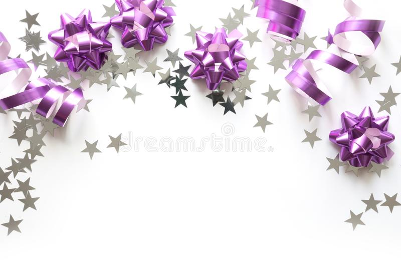 Christmas border of silver and pink pastel decoration, balls , tinsel, star, glitter on white. Xmas. Flat lay. Top view with copy. Christmas border of silver and stock images