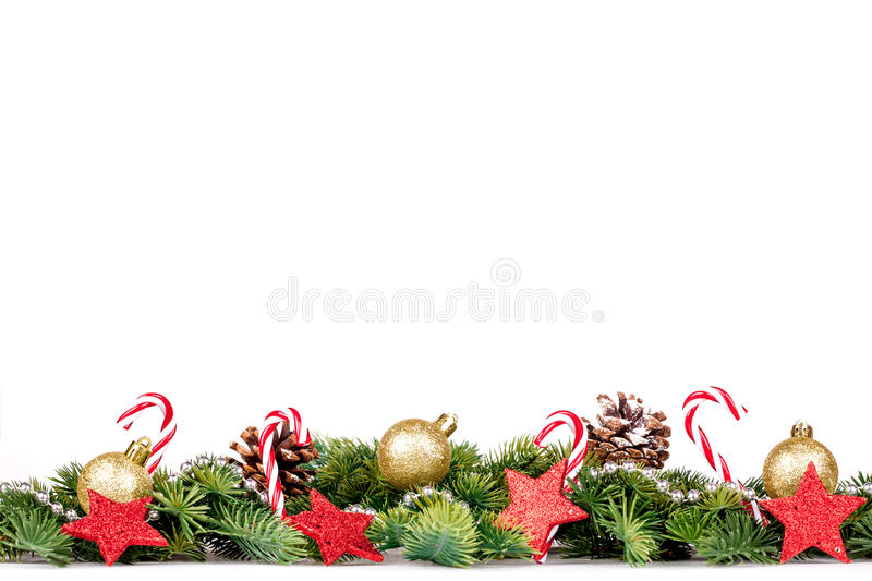Christmas Border - tree branches with golden balls, candy and decoration. Christmas Border - tree branches with golden balls, candy and big star isolated on royalty free stock photo