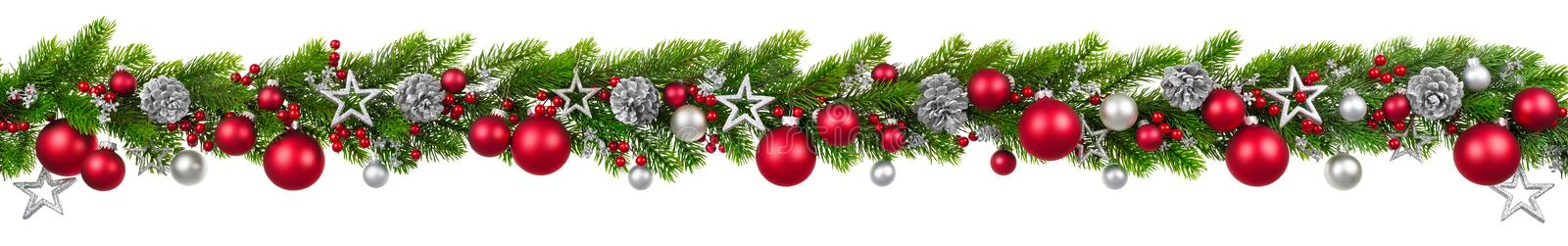 Christmas border on white, hanging decorated garland royalty free stock photography