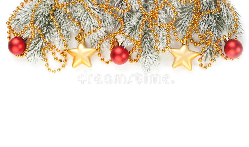 Christmas Border. Xmas winter tree branches with golden baubles, garland and stars isolated on white background.  royalty free stock photo