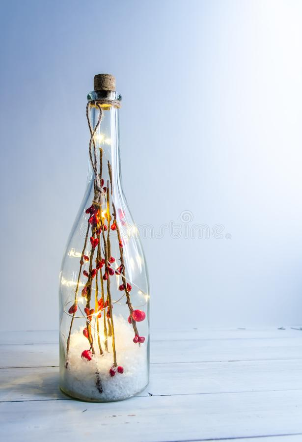Christmas bottle with lights on a white background. With copy space stock photography