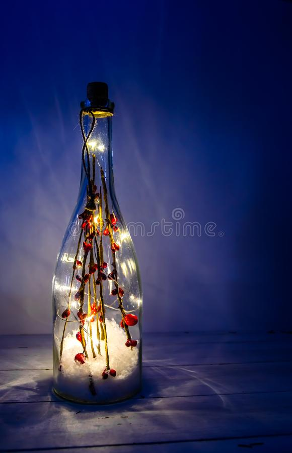 Christmas bottle with lights on a white background. With copy space stock photo