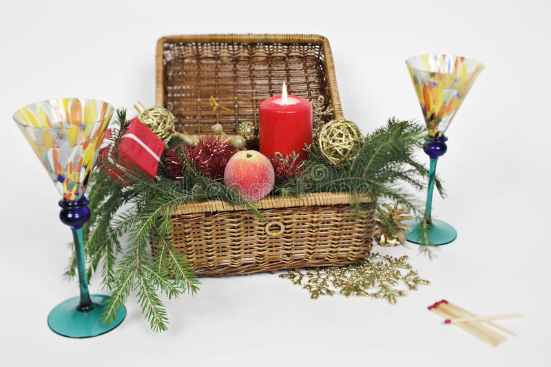 Christmas box. Candle in the box with Christmas toys around. Two glasses on both sides of the box. Focal plane goes from left low to right up corner royalty free stock images