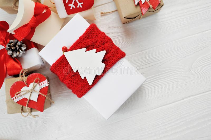Christmas boxes gift decorated with red bows on a white wooden background. Flat lay, top view photo mockup royalty free stock image