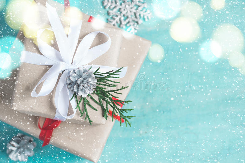Christmas boxes of gifts festively decorated On a turquoise background. Selective focus stock photos
