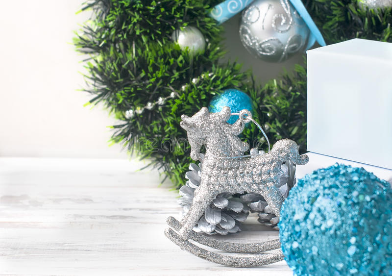 Christmas branches, balls, beads, cones, Christmas background. Christmas background. Merry Christmas branches,gift box, balls, ribbon, cones, Blue and white stock photos