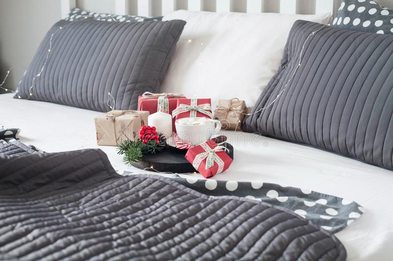 Christmas Breakfast in bed with a Cup of Coffee gift boxes, garlands and Christmas composition. royalty free stock photography