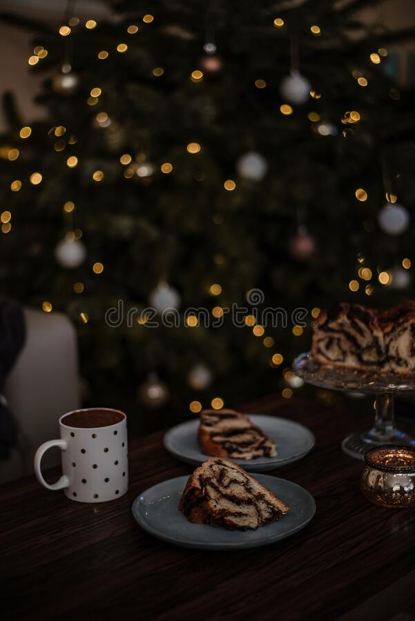 Christmas breakfast made cozy with home baked chocolate wreath and hot cocoa in cute cup. royalty free stock images