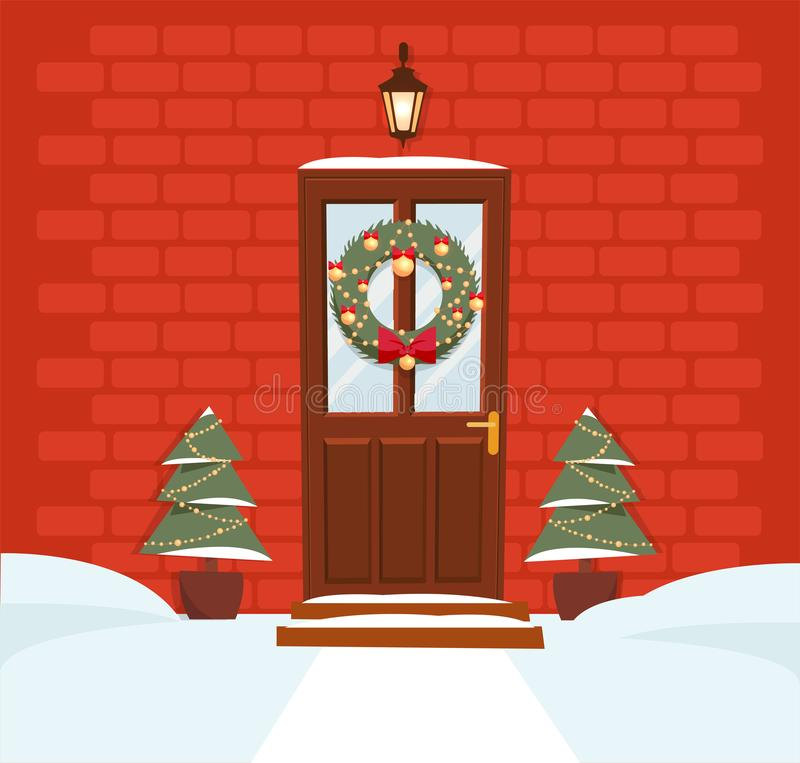 Christmas brown door with wreath, snow and firs on background of a dark red brick wall. Forged lantern above the door shines. The royalty free illustration
