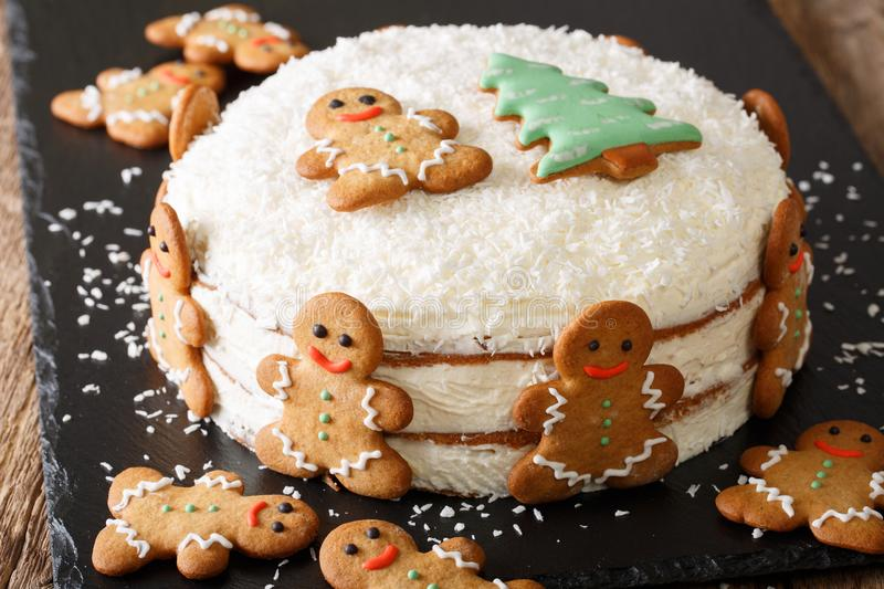 Christmas cake is decorated with gingerbread men close-up. horizontal royalty free stock images