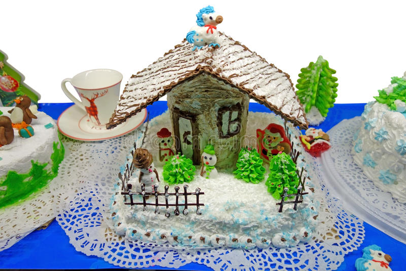 Christmas cake. Home-made Christmas cake with a winter theme. Year of the Horse stock images