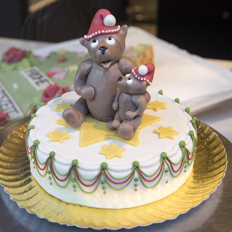Christmas cake topped with Teddy in Santa hat. Unique Christmas cake with marzipan Teddies in Santa hats royalty free stock photo
