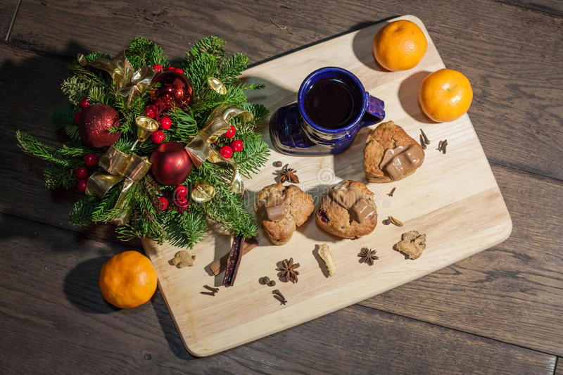 Christmas cakes. With hot wine and orages royalty free stock photo
