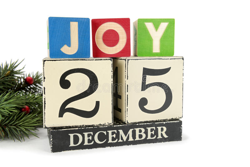 Christmas calendar with 25th December on wooden blocks royalty free stock images