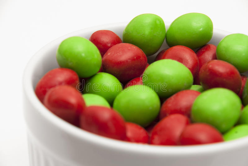 Christmas Candies - Angle. Red and green Christmas candies in a white ramekin stock images