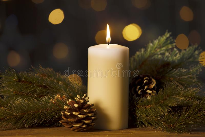 Christmas candle with branches and pine cones royalty free stock photos