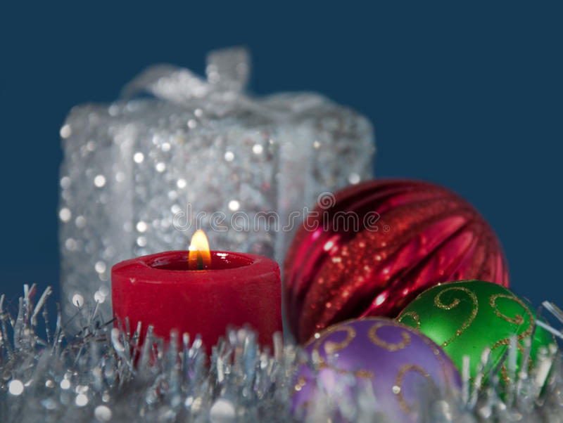 Download Christmas Candle Burning In The Middle Of Tinsel Stock Image - Image of tradition, candle: 26310575
