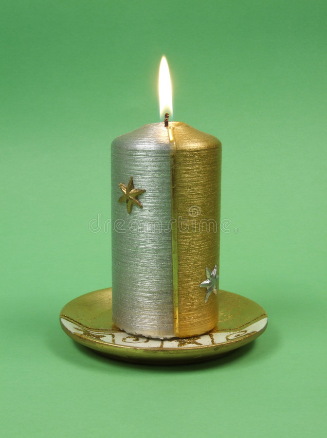 Christmas candle glowing royalty free stock photography