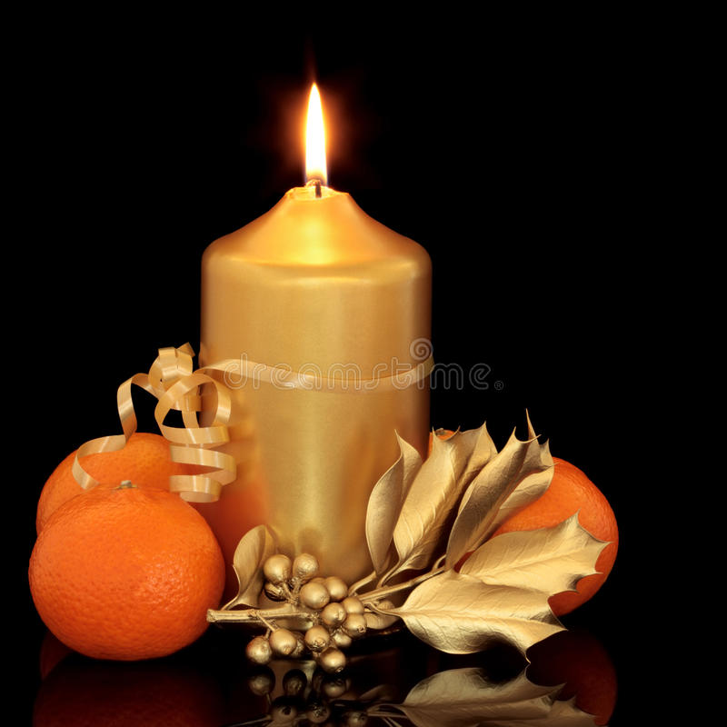 Christmas Candle, Holly and Fruit royalty free stock photo
