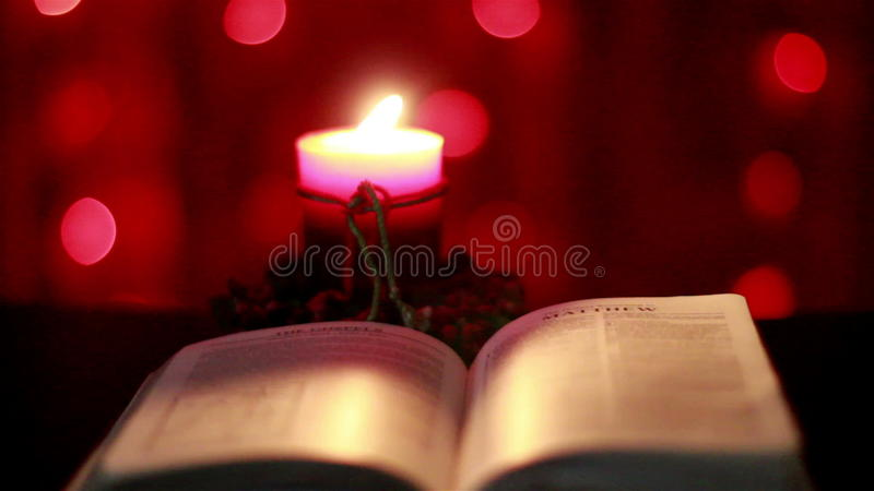 Is Christmas In The Bible.Christmas Candle And Open Bible Stock Footage Video Of