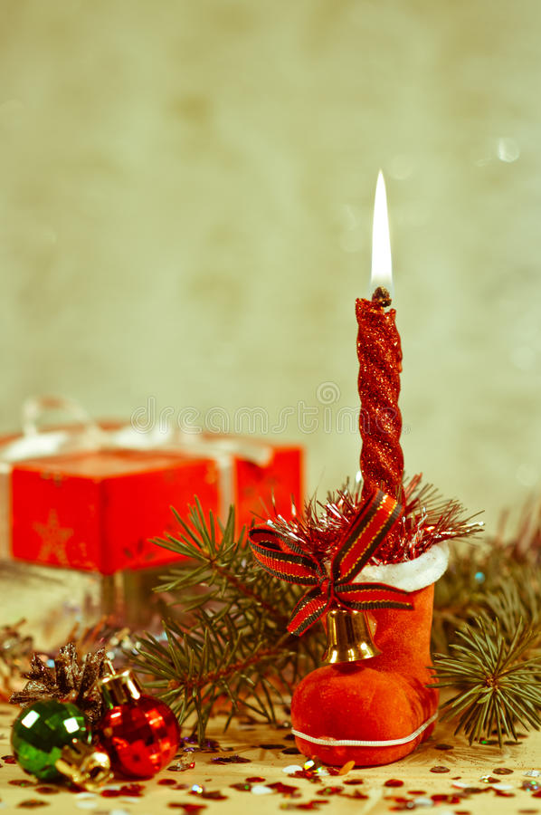 Christmas Candle In A Red Boot Stock Photography