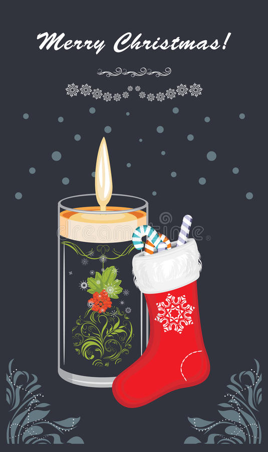 Christmas candle and sock on the dark blue background. Postcard royalty free stock photo
