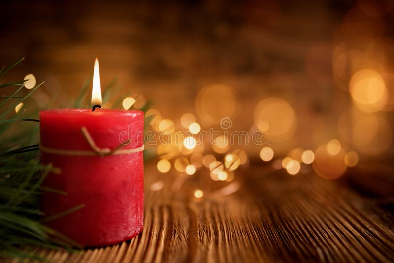 Christmas candle on wooden table stock photography
