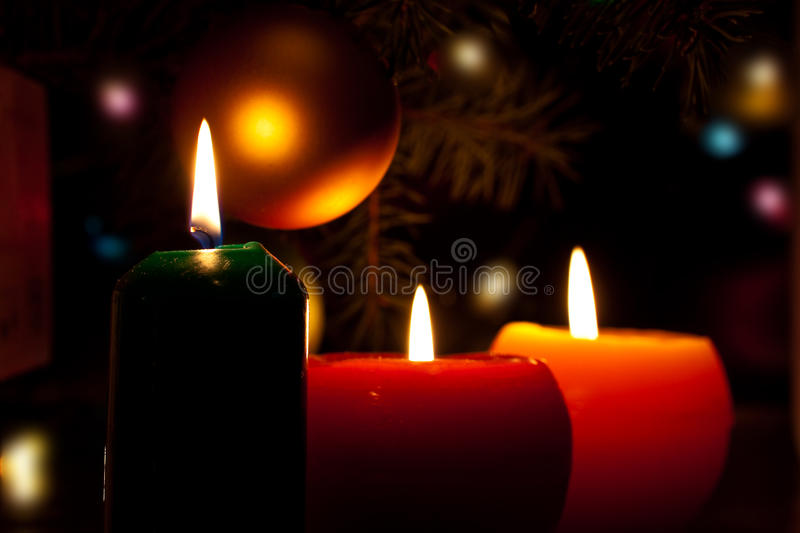 Christmas candles and baubles on dark