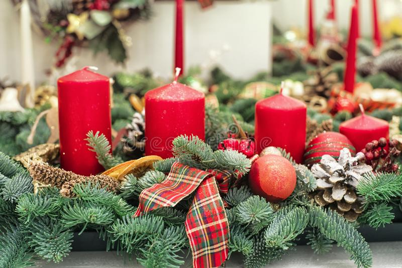 Christmas candles decoration with flowers on a table,Decorative Christmas tree branches with candle royalty free stock photography