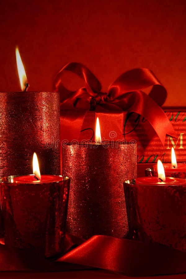 Christmas candles on vintage background stock photos