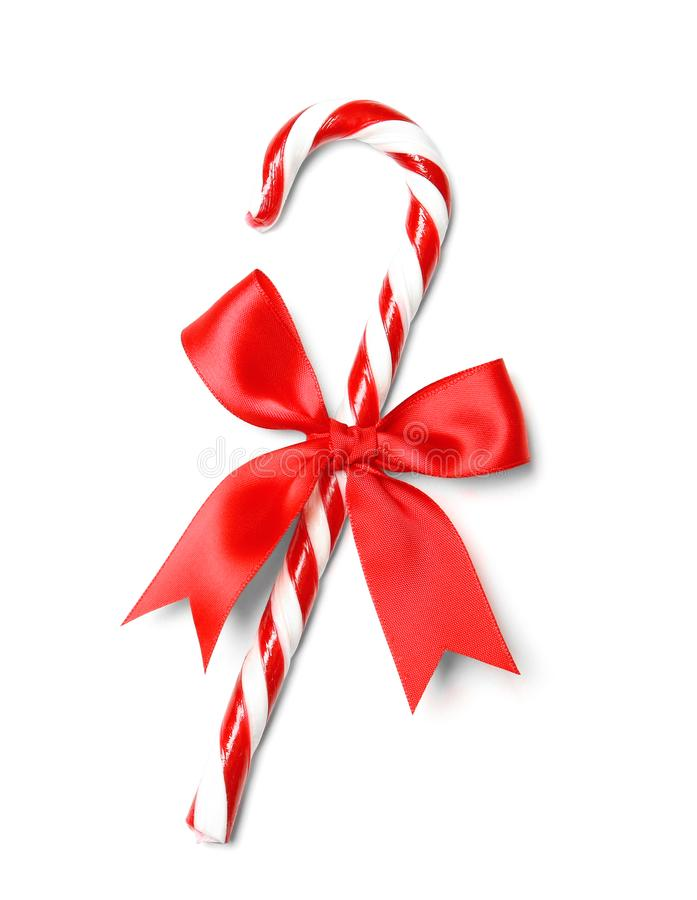 Christmas candy cane with bow isolated. On white royalty free stock photography