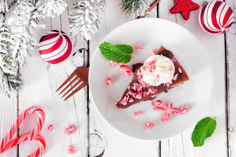 Christmas candy cane chocolate cheesecake, top view table scene against white wood. Christmas candy cane chocolate cheesecake. Top view table scene against a royalty free stock photos