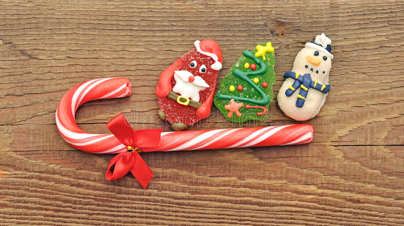 Christmas candy cane with cristmas toy stock images