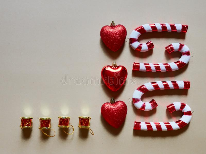 Christmas candy cane drums hearts and gifts at studio above view over a brown cream neutral background isolated. Flatlay stock photos
