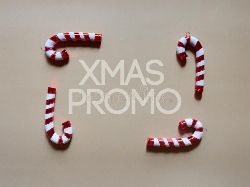 Christmas candy cane drums at studio above view over a brwon cream neutral background isolated. Flatlay stock photography