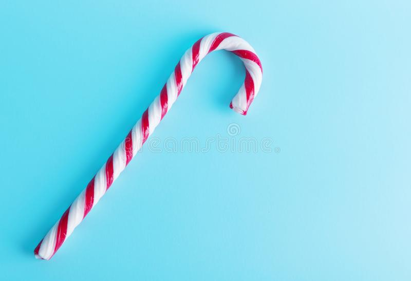 Christmas Candy Canes isolated on pastel blue background. Minimal composition. New Year concept. festive minimalism stock photography