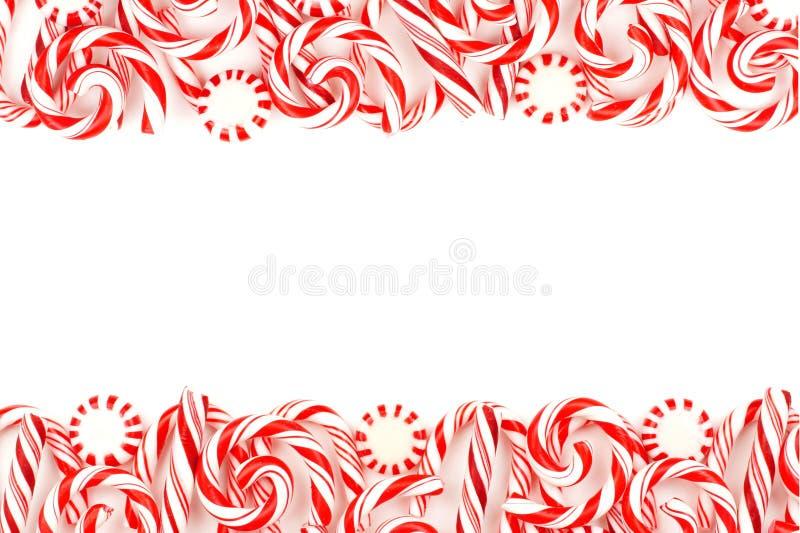 Christmas candy double border over white stock photos
