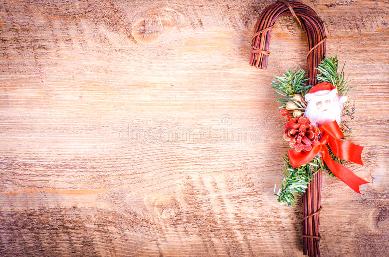 Christmas cane on wooden background. New Year. Christmas cane and cup of tea on wooden background. Christmas and New Year decoration. Free space for text royalty free stock photos