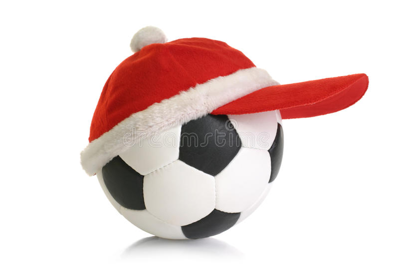 Christmas cap on soccer ball stock images