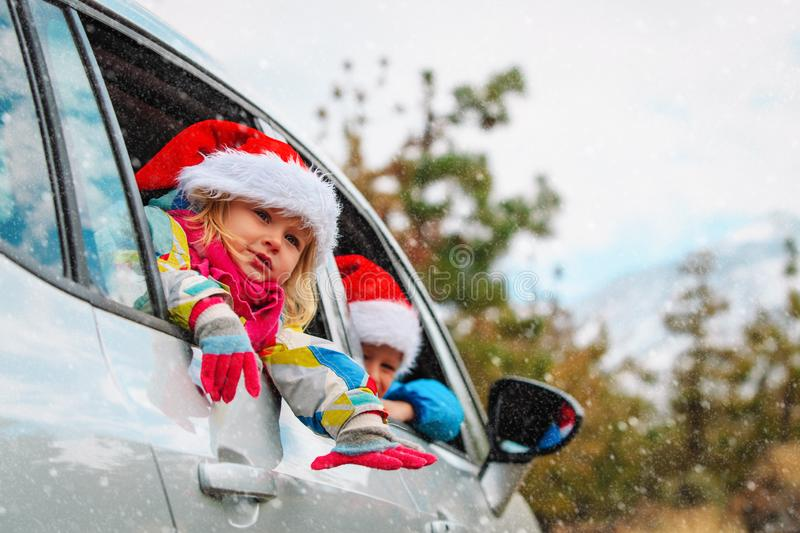 Christmas car travel- happy kids travel in winter. Nature stock photos