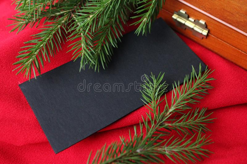 Christmas card background. New year holiday. Christmas still life. The view from the top. Free space for text. Green pine branches. On a red background stock photography