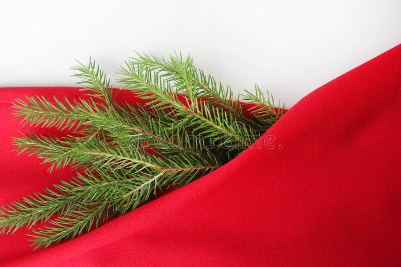 Christmas card background. New year holiday. Christmas still life. The view from the top. Free space for text. Green pine branches. On a red background royalty free stock images