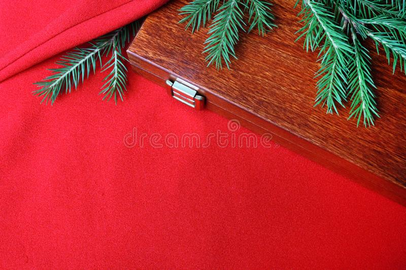 Christmas card background. New year holiday. Christmas still life. The view from the top. Free space for text. Green pine branches. On a red background royalty free stock image